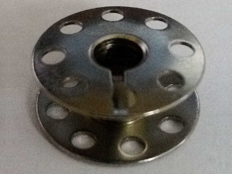 Szpulka do maszyny stębnówki JUKI z serii DDL oraz innych stębnówek SIRUBA, BROTHER, PFAFF itp