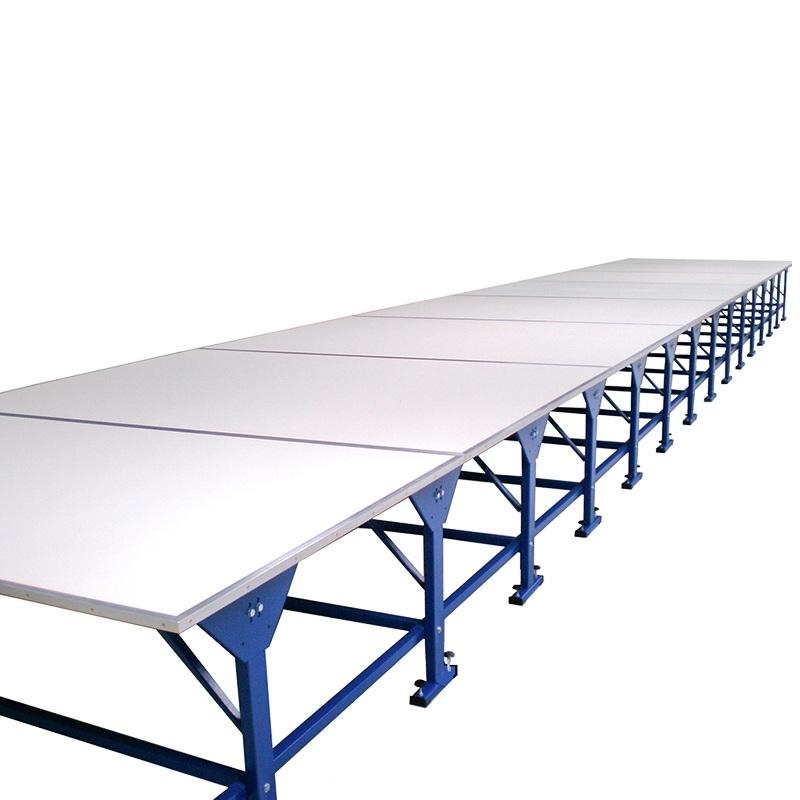 Profesjonalny stół krojczy o modułowej budowie. Długości od 2m do 22,6m. Do każdej krojowni.